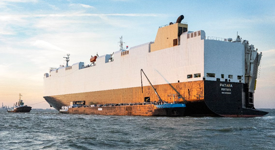 The cargo vessel with the vehicles